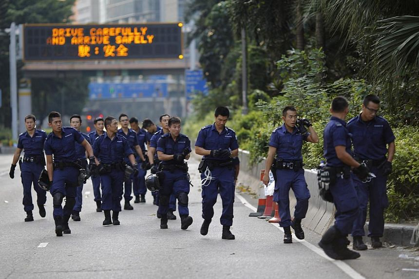Policemen near the main protest site in Admiralty in Hong Kong on Oct 13, 2014. -- PHOTO: REUTERS
