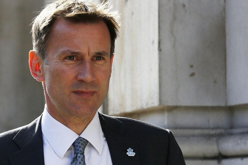 Britain's Health Secretary Jeremy Hunt seen arriving at the Cabinet Office in London on Oct 8, 2014. -- PHOTO: REUTERS