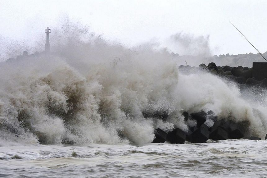 High waves batter a breakwater at a port of Kawaminami town in Miyazaki prefecture, Japan's southern island of Kyushu on Oct 13, 2014. -- PHOTO: AFP