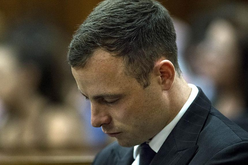 South African Paralympic athlete Oscar Pistorius looks down while his phycologist gives evidences during his sentencing hearing at the High Court in Pretoria, South Africa on Oct 13, 2014. -- PHOTO: AFP