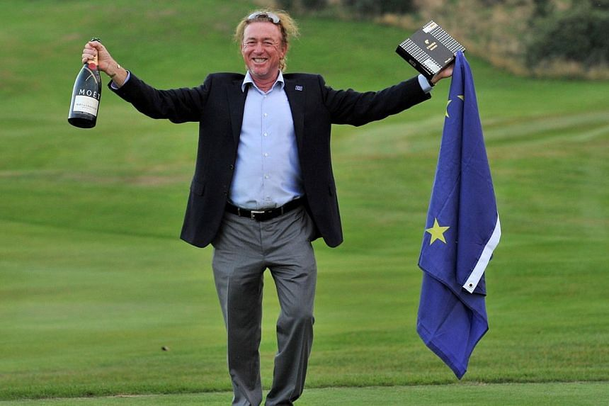 Vice-captain of Team Europe Miguel Angel Jimenez of Spain celebrates after Team Europe retained the Ryder Cup on the final day of the Ryder Cup golf tournament at the Gleneagles Hotel in Gleneagles, Scotland, on Sept 28, 2014. -- PHOTO: AFP