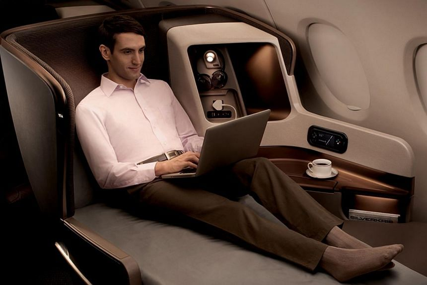 Singapore Airlines (SIA) new business class seat on Boeing 777-300 ER. The cost of business-class flights to London and New York have dropped in all cities, except Manila, where they have risen 4 per cent. -- PHOTO: SINGAPORE AIRLINES