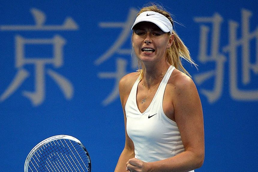 Maria Sharapova of Russia reacts after winning a point aqainst Petra Kvitova of the Czech Republic in the women's singles final at the China Open tennis tournament in the National Tennis Center of Beijing on Oct 5, 2014. -- PHOTO: AFP