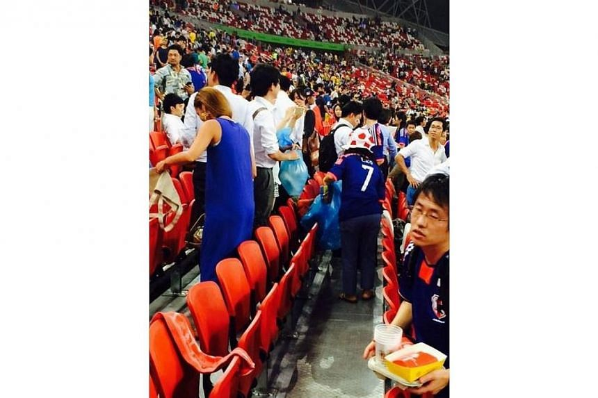 A fan at the Sports Hub during the Brazil-Japan friendly match tweeted this picture of Japanese fans cleaning up. -- PHOTO: TWITTER/BK