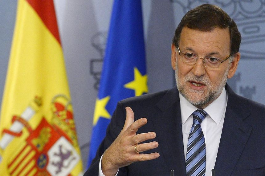 Spanish Prime Minister Mariano Rajoy speaks during a press conference after an extraordinary cabinet meeting on the Catalonia independence vote on Sept 29, 2014, at the Moncloa Palace in Madrid. Mr Rajoy on Tuesday hailed the decision by Catalan lead