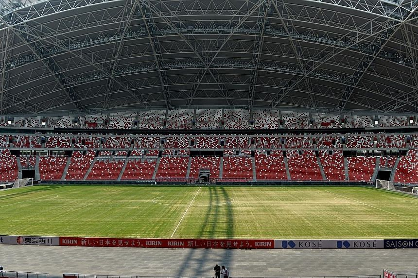"""The National Stadium's sandy pitch has sprouted a sprinkling of hilarious jokes and memes on social media, with many Twitter users using the hashtag """"yourpitchissosandy"""" to jest at the lack of grass growing on the pitch. -- ST PHOTO:JAMIE"""