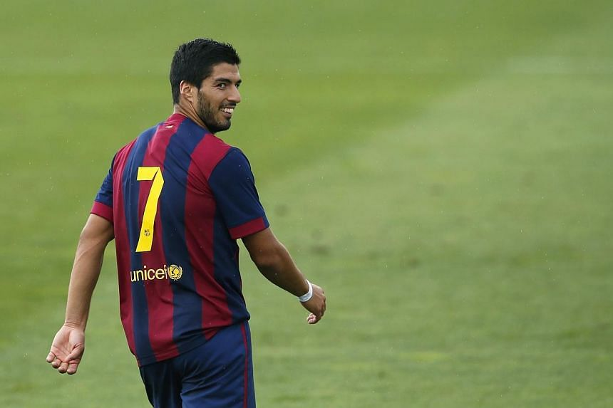 Barcelona's Luis Suarez smiles to the crowd during a friendly soccer match against Indonesia U19 near Barcelona on Sept 24, 2014. -- PHOTO: REUTERS