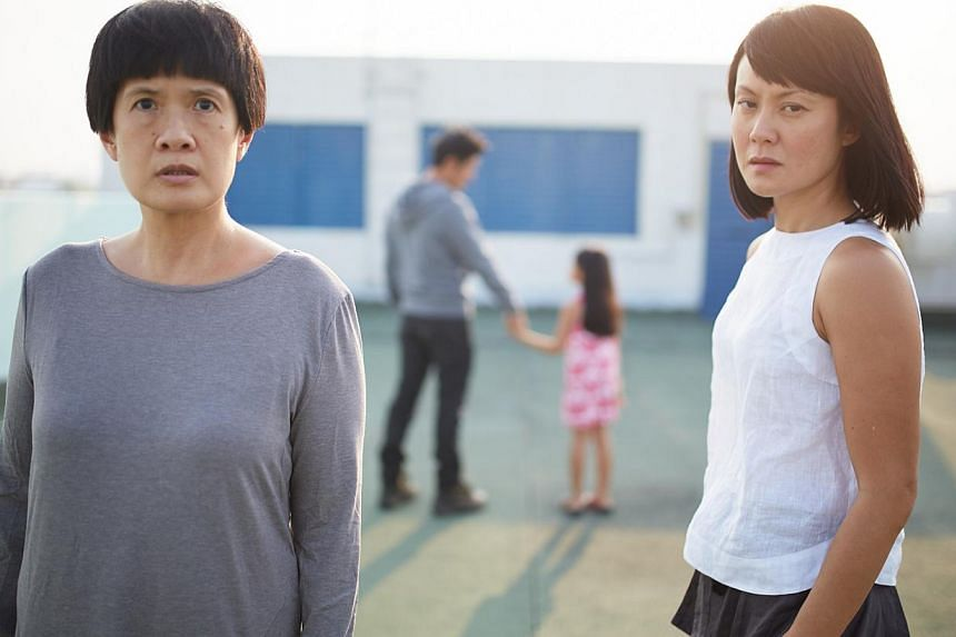 Karen Tan (left) as the grieving mother of a murdered girl, Janice Koh (right) as a psychiatrist who studies serial killers, while Adrian Pang (background) is the shadowy man who could be viewed as a monster or loner. -- PHOTO: CRISPIAN CHAN