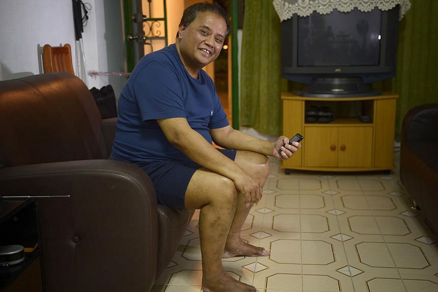 Suhaimi Mansoor, 58, is a beneficiary of StarHub's programme. -- ST PHOTO:MARK CHEONG