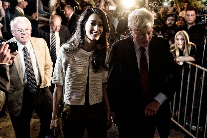 Amal Alamuddin Clooney (left) and lawyer Geoffrey Robertson arriving to a central Athens hotel, as a part of a team advising the government on the return of the Parthenon Marbles from Britain. -- PHOTO: AFP