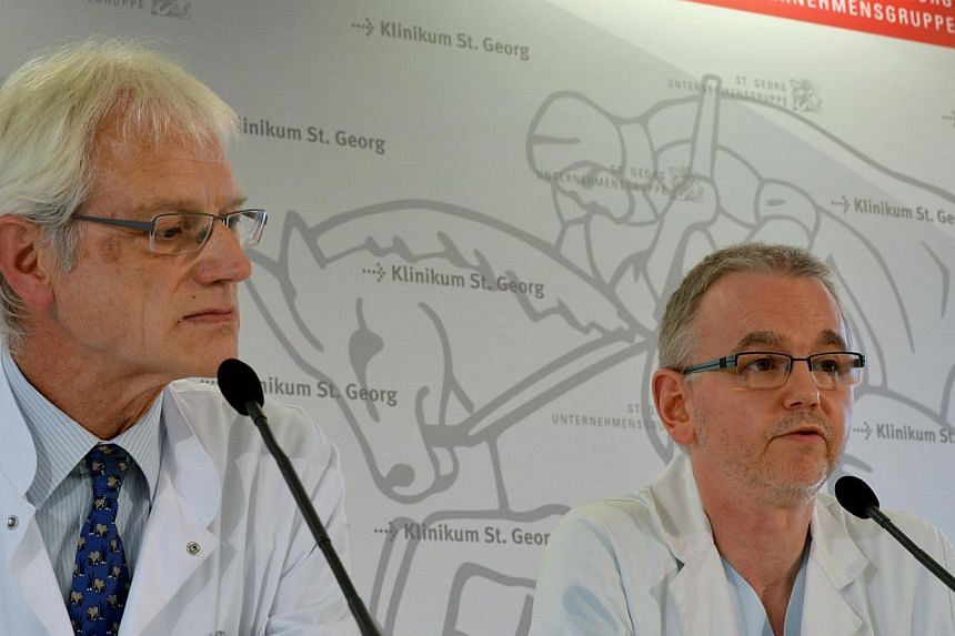 Chief doctor Bernhard Ruf (left) und senior physician Thomas Grünewald address a press conference at the St Georg Clinic in Leipzig, eastern Germany on Oct 9, 2014. -- PHOTO: AFP