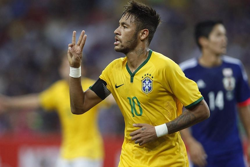 Brazil's Neymar gestures as he celebrates after scoring his hat-trick against Japan during their friendly soccer match at the national stadium in Singapore on Oct 14, 2014. -- PHOTO: REUTERS