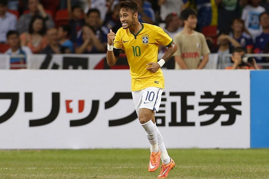 Brazil's Neymar celebrates after scoring against Japan during their friendly soccer match at the national stadium in Singapore on Oct 14, 2014. -- PHOTO: REUTERS