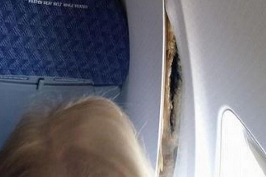 A passenger onboard American Airlines flight AA2293 posted this picture of the plane's wall panels coming loose mid-flight. -- PHOTO: JAMES WILSON'S FACEBOOK PAGE