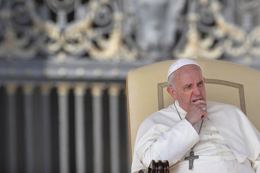 Pope Francis gives his weekly general audience at St Peter's square on Oct 8, 2014 at the Vatican. -- PHOTO: AFP