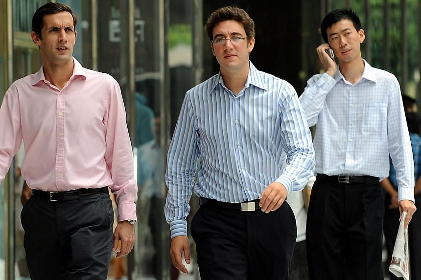 Office workers walking past the Raffles Place MRT station during lunch time in this file photo. --STPHOTO: JOYCE FANG