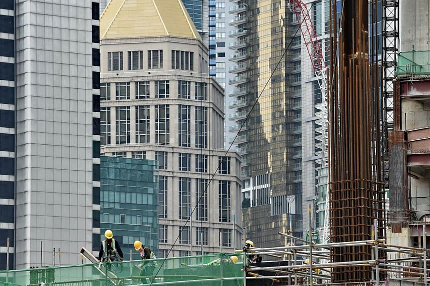 The latest set of economic numbers, released by the Ministry of Trade and Industry on Tuesday morning, show that property cooling measures and foreign manpower curbs have started to bite, economists said. -- PHOTO: AFP