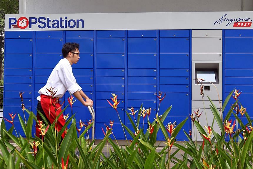 Users can now post parcels and pay for their purchases through Singapore Post's POPStations (Pick Own Parcel Station). -- PHOTO: ST FILE