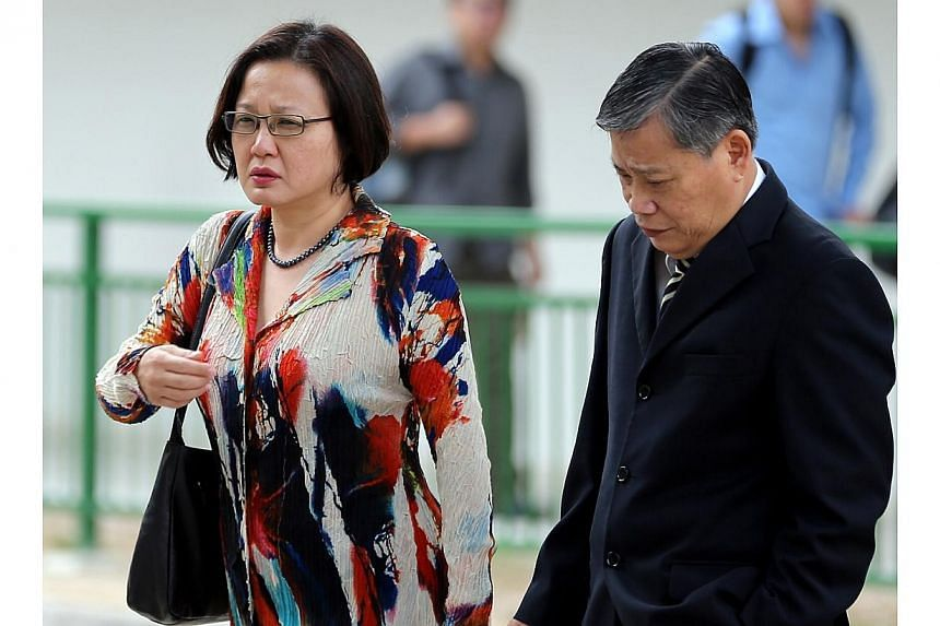 Aljunied-Hougang-Punggol East Town Council chairman Sylvia Lim and Mr Peter Low, lawyer for the town council, arriving at the State Courts on Wednesday. -- ST PHOTO: WONG KWAI CHOW