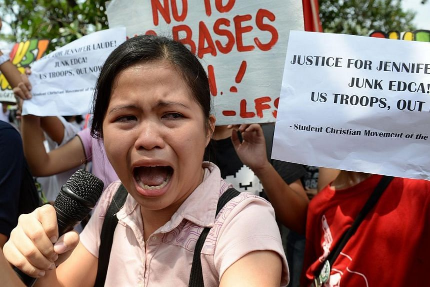 A Filipino student leader speaks as she becomes emotional during a rally in front of the US embassy in Manila on Oct 14, 2014 as protesters condemned the murder of a local transgender person and the presence of US troops.The Philippines on Wedn