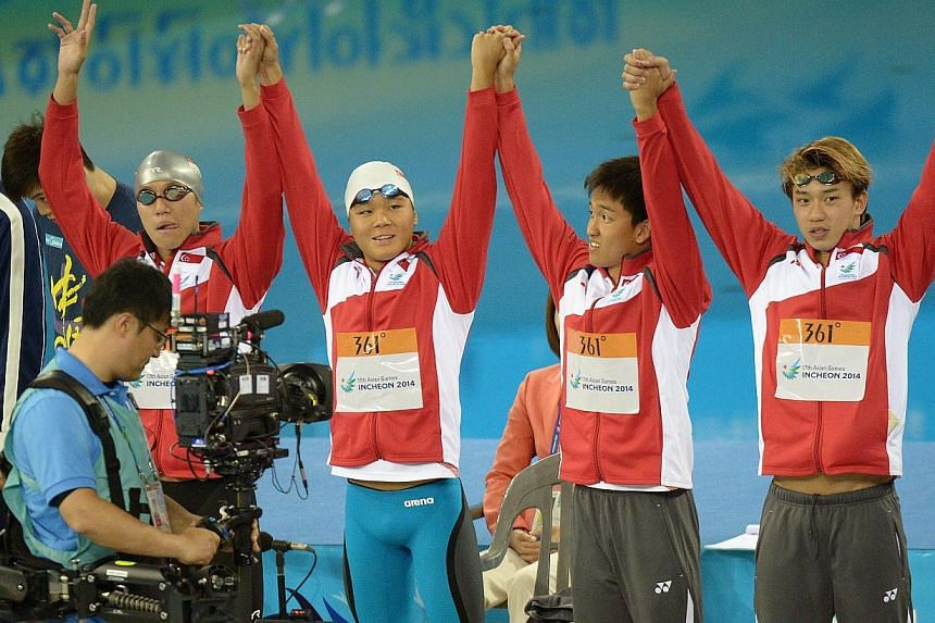 Singapore quartet (from left) Danny Yeo, Pang Sheng Jun, Teo Zhen Ren and Clement Lim, rewrote the national 4x200m freestyle relay record at the Asian Games in Incheon, on 22 Sept 2014. -- PHOTO: ST FILE