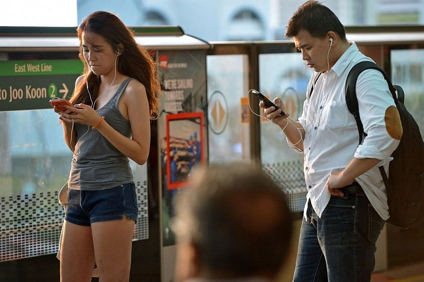 The authorities want to use consumers' mobile phones to better gauge the quality of telcos' mobile services. -- PHOTO: ST FILE