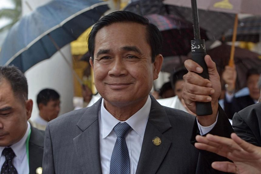 Thai junta leader and Prime Minister Prayut Chan-O-Cha smiles as he visits the Shwedagon pagoda as part of his official visit to Myanmar on Oct 10, 2014. -- PHOTO: AFP