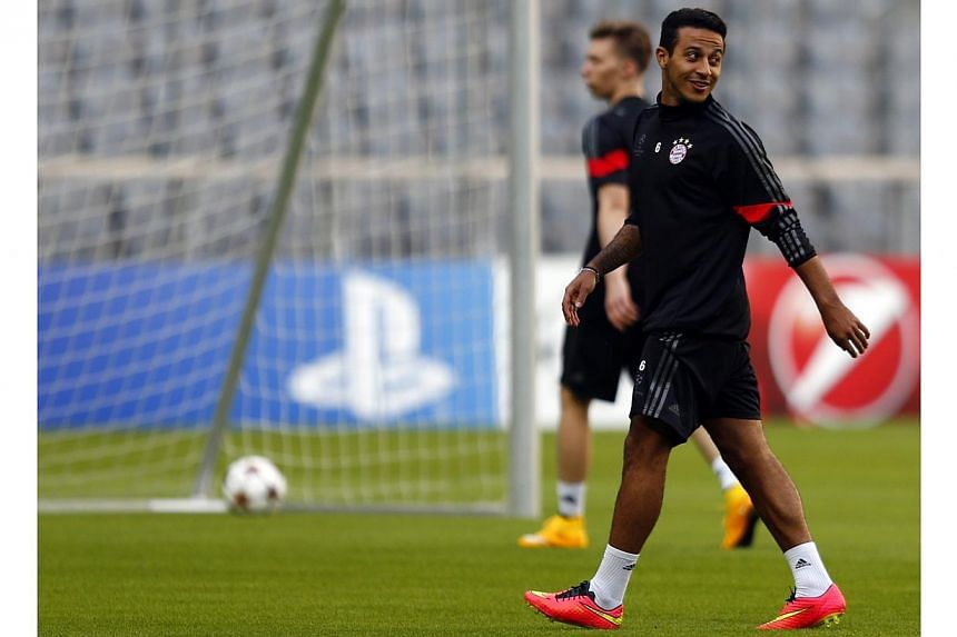 Bayern Munich's Thiago Alcantara attends a training session before their Champions League group E soccer match against Manchester City, in Munich on Sept 16, 2014. -- PHOTO: REUTERS