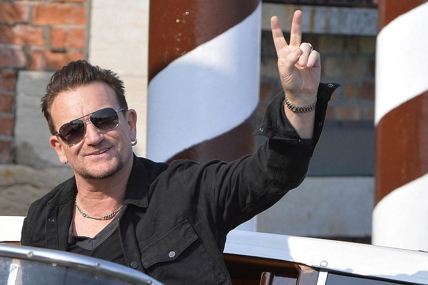 Irish singer and frontman of U2, Bono, arriving at the Cipriani Hotel in Venice for the wedding of US actor george Clooney with British Amal Alamuddin in Venice onSept 27, 2014.Bono is sorry for giving away U2's latest album for free on i