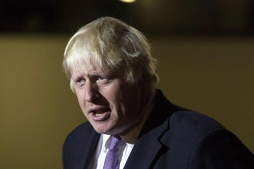 Mayor of London Boris Johnson speaks to the media after winning selection as the Conservative candidate for the constituency of Uxbridge and South Ruislip in London on Sept 12, 2014. -- PHOTO: REUTERS