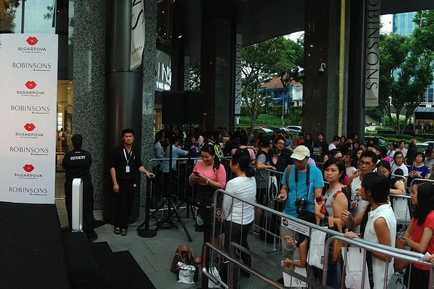 Maria Sharapova fans waiting outside Robinsons The Heeren on Oct 15, 2014. -- PHOTO: CAROLINE CHIA