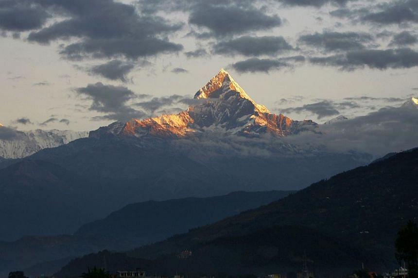 Mount Machhapuchhre, which stands at 6993 metres and forms part of the Annapurna region, is seen from Pokhara, some 200kms west of the Nepalese capital Kathmandu on Nov 1, 2010.Nine trekkers – eight foreigners and a local man – have been ki