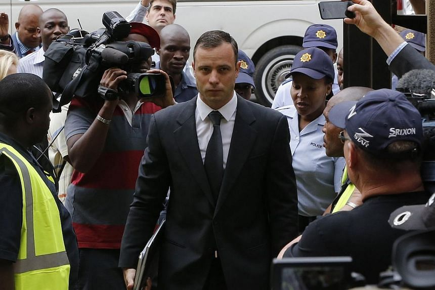 South African Olympic and Paralympic sprinter Oscar Pistorius arrives at the North Gauteng High Court in Pretoria on Oct 15, 2014. Lawyers for Reeva Steenkamp's family on Wednesday expressed shock that Pistorius's defence team revealed details o