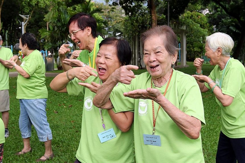 A group of elderly citizens engaging in laughter yoga at Tiong Bahru Park.-- PHOTO: ST FILE