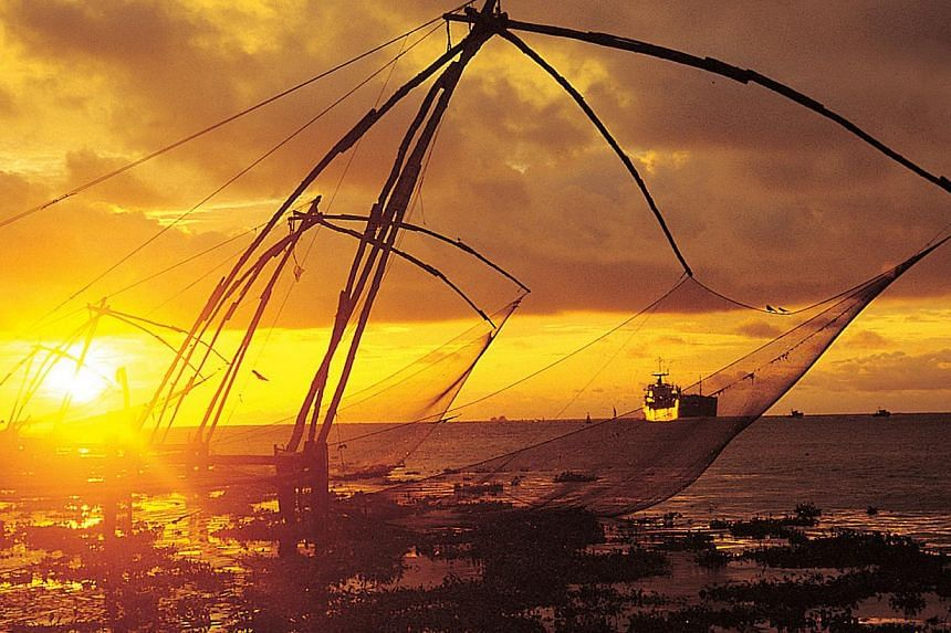 The Chinese fishing nets in Fort Kochi. These giant cantilevered nets look like something out of the Flintstones, their crude wooden frames fixed to the shore and then lowered manually in and out of the water. -- PHOTO: ST FILE