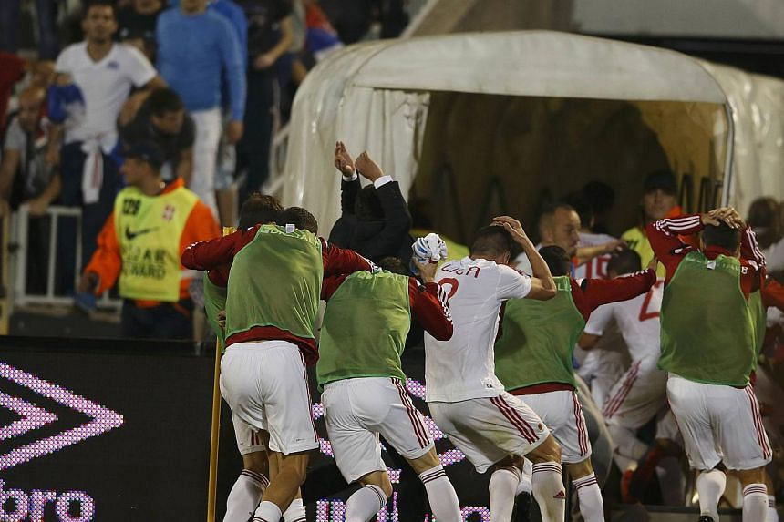 Albania's players retreat into the tunnel during their Euro 2016 Group I qualifying soccer match against Serbia at the FK Partizan stadium in Belgrade on Oct 14, 2014. -- PHOTO: REUTERRS