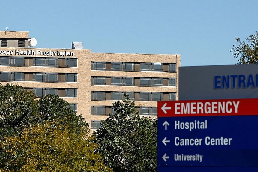 The Texas Health Presbyterian Hospital, where health care worker Nina Pham, is being treated for the Ebola virus is seen on Oct 14, 2014, in Dallas, Texas. -- PHOTO: AFP
