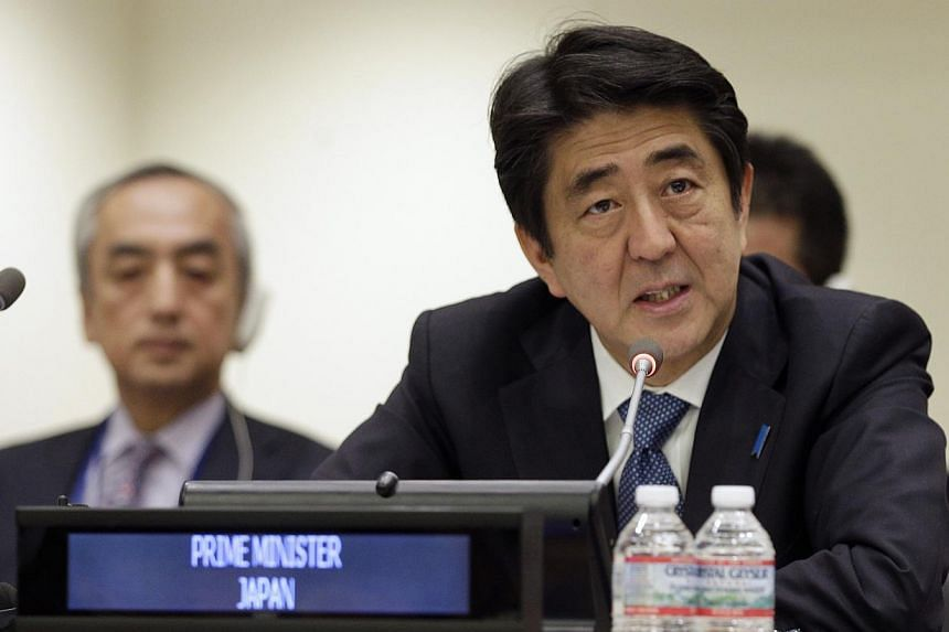 Japan's Prime Minister Shinzo Abe addresses a high-level summit on strengthening international peace operations during the 69th session of the United Nations General Assembly at United Nations headquarters in New York. -- PHOTO: REUTERS