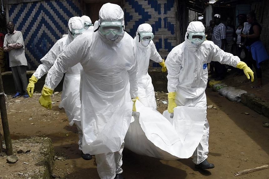 Red Cross workers carry away the body of a person suspected of dying from the Ebola virus, in the Liberian capital Monrovia, on Oct 4, 2014. A Las Vegas company, seeking to capitalise on the world's worst Ebola outbreak on record, is looking to sell