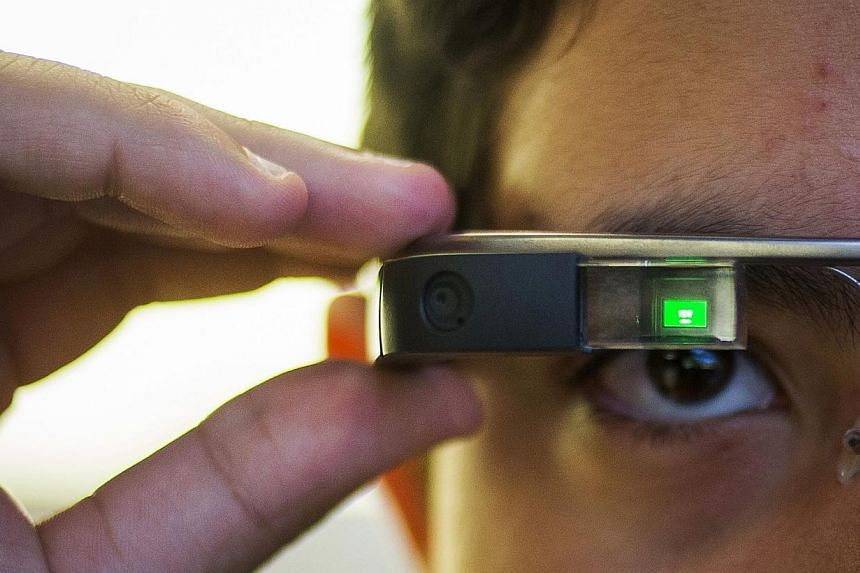 A 31-year-old American was treated for addiction after wearing Google Glass (as modelled above in New York in September 2014) for up to 18 hours a day and even experienced dreams as if looking through the device, doctors said. -- PHOTO: REUTERS