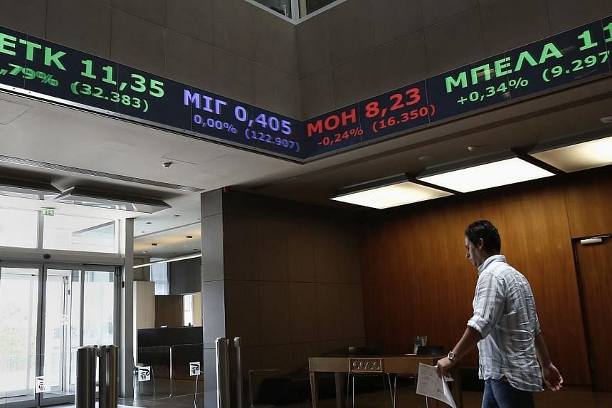 Greek bonds and stocks slumped on Wednesday as investors fretted about the political situation in the country and the government's intention to end its IMF programme early. -- PHOTO: REUTERS