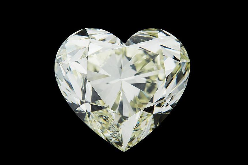 52ct heart-shaped diamond. Jeweller: Afghan Malaya Trading Co. Pavilion/Booth: Exquisite/EP211. Price: S$2,912,500.-- PHOTO: UBM MEDIA