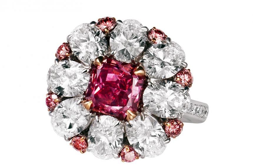 Purplish red diamond, 1.61ct set in platinum and 18k white gold surrounded by white diamonds, total 4.11ct, pink diamonds 0.62ct (ring). Jeweller: Glajz-Thg. Pavilion/Booth: Exquisite / EP111. Price: S$3,125,000.-- PHOTO: UBM MEDIA