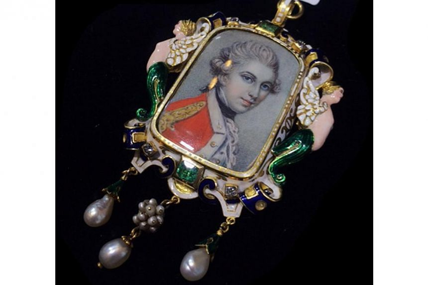 Austro-Hungarian Victorian large pendant made of 18K gold diamond emerald and enamel, circa 1850. Jeweller: Revival Jewels. Pavilion/Booth: Exquisite/EP321. Price: S$37,500.-- PHOTO: UBM MEDIA