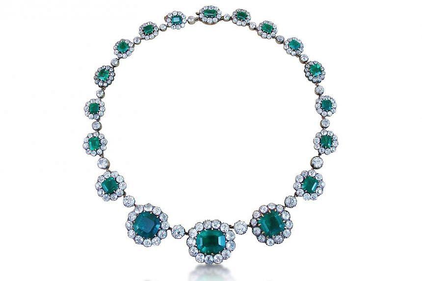 Antique Columbian emerald and diamond ear pendants, circa 1890. Jeweller: Revival Jewels. Pavilion/Booth: Singapore/D105. Price on asking.-- PHOTO: UBM MEDIA