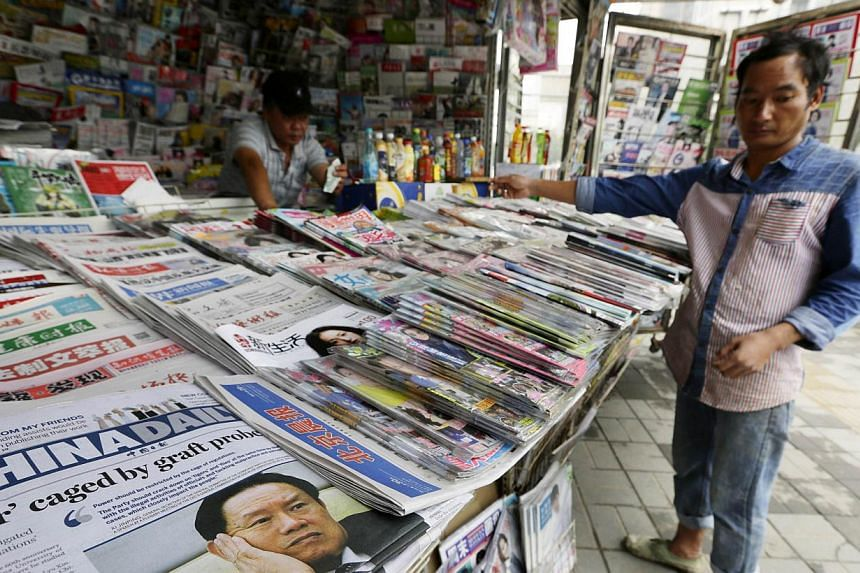 "A newspaper stand in Beijing on July 30, 2014. Since the Hong Kong protests began on Sept 28, Chinese Communist Party media outlets have published at least one commentary a day without fail by ""Guo Ping"". On some days, ""Guo Ping"" wrote two commentari"