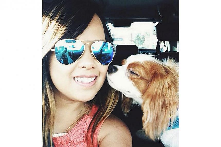 Texas health-care worker Nina Pham is pictured in a photo provided by her family. Pham, who became infected with Ebola while caring for a Liberian man who died of the illness, said on Tuesday that she is doing well, according to a hospital statement.