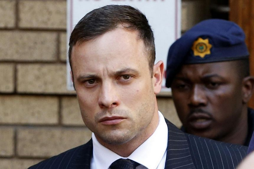 South African Olympic and Paralympic sprinter Oscar Pistorius leaves the North Gauteng High Court in Pretoria Oct 14, 2014. Pistorius returned to the court on Tuesday on the second day of sentencing procedures for the negligent killing of his model g