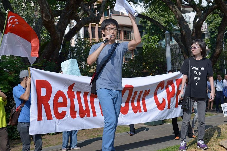 Roy Ngerng (centre) and Han Hui Hui (right) speaking at the Return Our CPF rally at Hong Lim Park on Sept 27, 2014. -- ST PHOTO: LIM SIN THAI