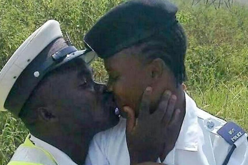 Three Tanzanian police officers have been fired after a photograph of two of them kissing went viral on social media. -- PHOTO:FADHIRI LINGA